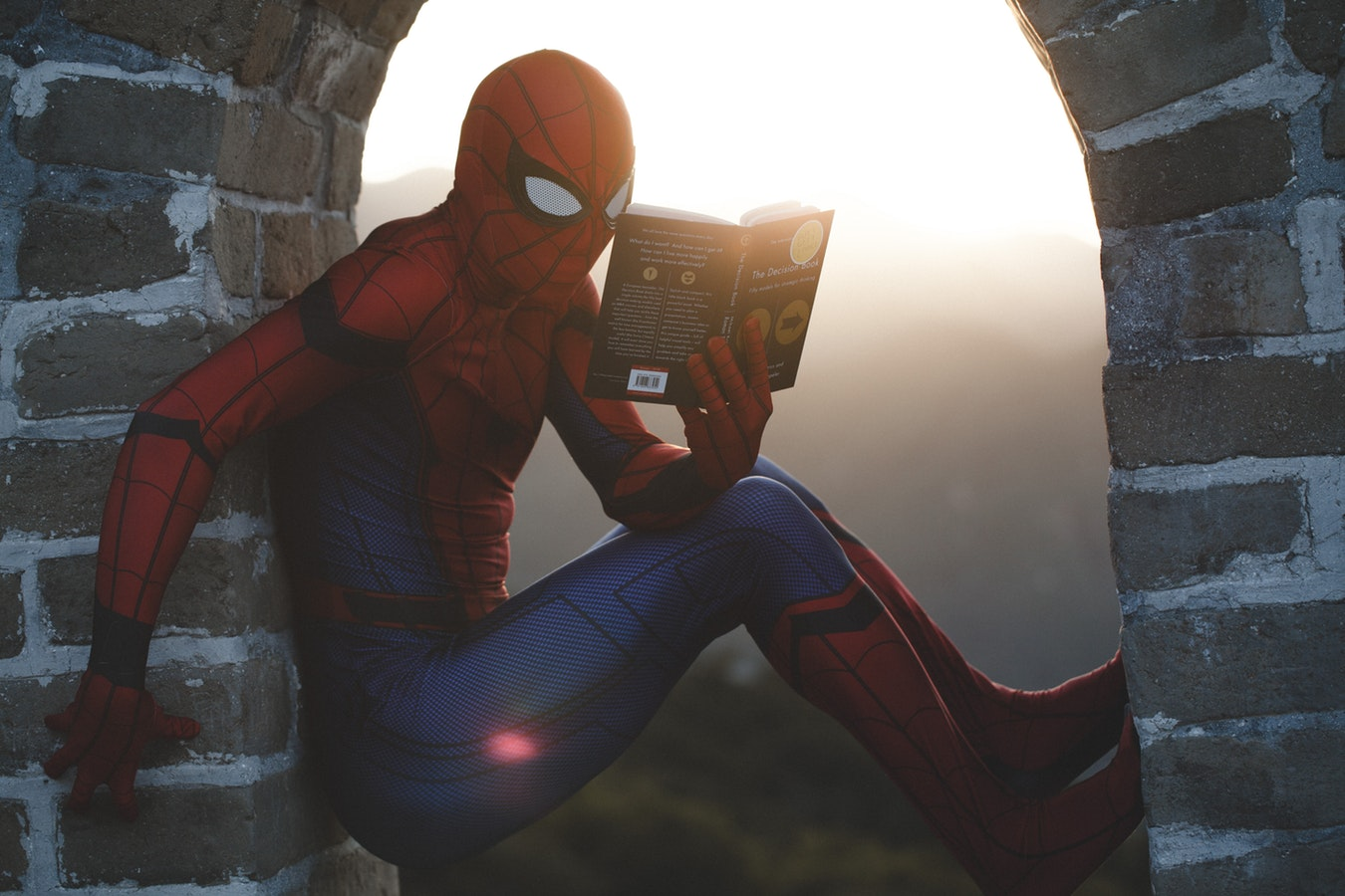 Spider Man with book - Unsplash Moodshot